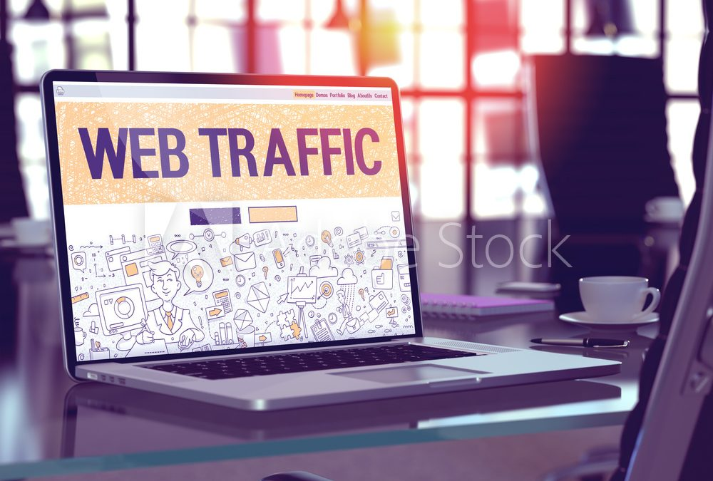 laptop showing a caption and screen page of web traffic for website design